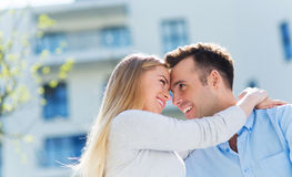 Young couple in modern residential area Stock Images