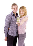 Young couple with money Stock Image