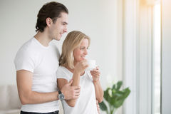 Young couple in the morning. Young couple feeling mutual respect, trust and honesty, calm environment at home, healthy relationships, meeting the morning Stock Images