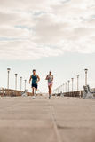 Young couple on morning run Royalty Free Stock Photography