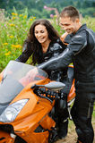 Young couple with motorbike Royalty Free Stock Photography