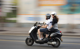 Young couple  on a motorbike Royalty Free Stock Images