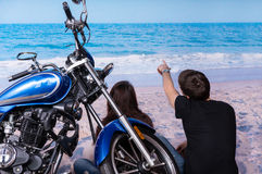 Young Couple with Motorbike Relaxing at the Beach Stock Images