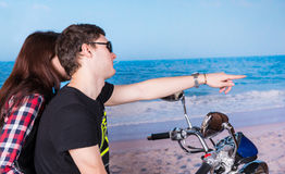 Young Couple on Motorcycle at Beach Stock Photo