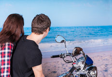 Young Couple on Motorcycle at Beach Stock Images