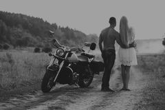 Young couple on a motorcycle in the field Stock Photography