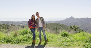 Young couple in mountains stock video footage