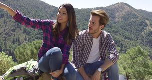 Young couple in mountains stock footage