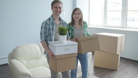 Smiling Young couple moves to a new apartment stock video