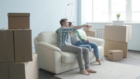 Smiling Young couple moves to a new apartment. Young couple moves to a new apartment stock footage