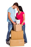 Young couple with moving boxes Royalty Free Stock Photos