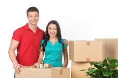 Young couple on moving day carrying cardboard boxes. Stock Photos