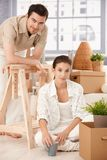 Young couple moving home boxes around smiling Stock Photography