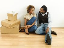 Young couple moving house Stock Images