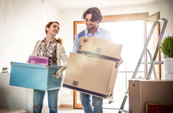 Young couple moving in into new apartment Stock Photography