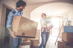 Young couple moving in into new apartment Royalty Free Stock Images