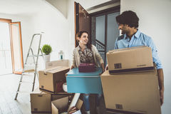 Young couple moving in into new apartment Royalty Free Stock Photography
