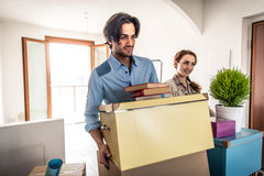 Young couple moving in into new apartment Royalty Free Stock Image