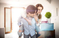 Young couple moving in into new apartment Royalty Free Stock Photos