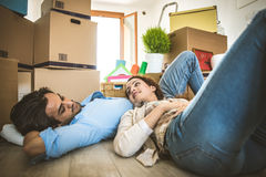 Young couple moving in into new apartment Stock Photos