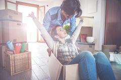 Young couple moving in into new apartment Stock Images
