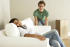 Young Couple Moving Into New Home Stock Photography
