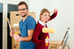 Young couple moving in new home Royalty Free Stock Images