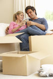 Young Couple Moving Into New Home Celebrating With Champagne Stock Photos