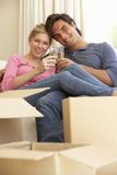 Young Couple Moving Into New Home Celebrating With Champagne Royalty Free Stock Image