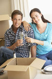 Young Couple Moving Into New Home Celebrating With Champagne Royalty Free Stock Photo