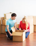 Young couple moving into a new home Royalty Free Stock Image