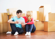 Young couple moving into a new home Stock Photos