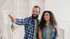 Moving new home life changing experience surprise. Young couple moving into new home. Life changing experience. Hipster guy surprised his gf with new apartment stock footage