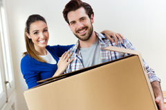 Young couple moving in new home Stock Photos