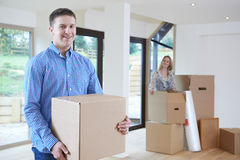 Young Couple Moving Into New Home Together royalty free stock photos