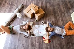 Young couple moving in new house, drinking coffee. Royalty Free Stock Photo