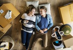 Young couple moving into new house royalty free stock photography
