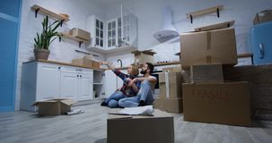 Young couple moving in their new home stock photo