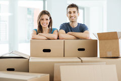 Young couple moving in their new home Stock Photos