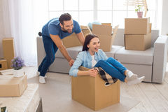 Young couple moving to a new apartment together relocation. Young couple men and women moving to a new apartment together relocation Stock Photography