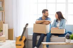 Young couple moving to a new apartment together relocation Stock Photography