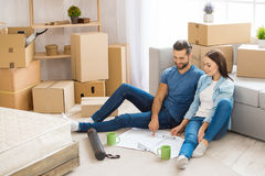 Young couple moving to a new apartment together relocation Stock Photos