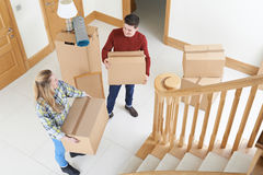 Young Couple Moving In To New Home Royalty Free Stock Images