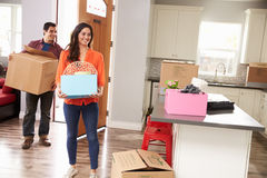 Young Couple Moving In To New Home Together royalty free stock images