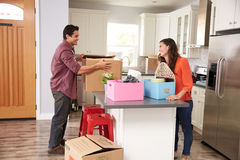 Young Couple Moving In To New Home Together Stock Image