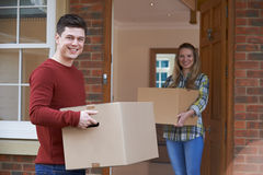 Young Couple Moving In To New Home Together Stock Images