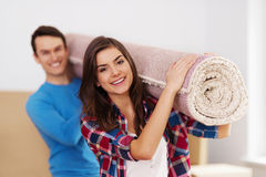 Couple holding a carpet Stock Photo