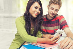 Young couple multi ethnic study together Royalty Free Stock Images