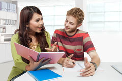 Young couple multi etnic study together Royalty Free Stock Photography
