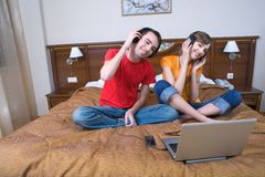 Young  couple with musical ear-phones Royalty Free Stock Images